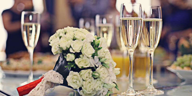 Bridal bouquet and champagne glasses